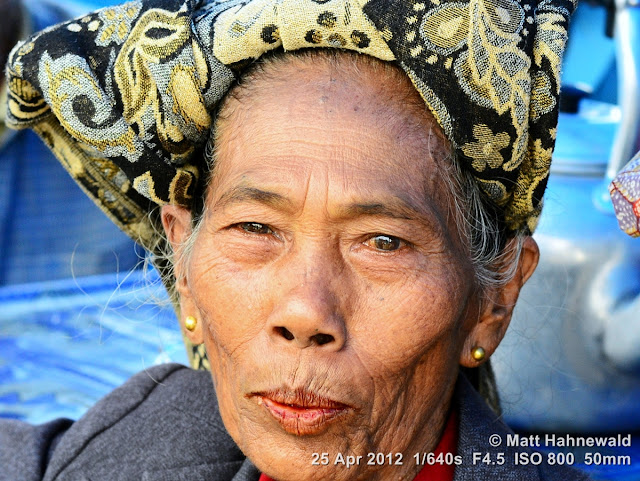 people, Batak woman, street portrait, Indonesia, Sumatra, Lake Toba, betel nut, betel quid, areca nut, sirih, paan, chewing tobacco, red coloured salivation