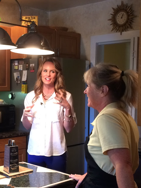 Owner Kim and TV personality woman discussing recipe to be featured on TV segment