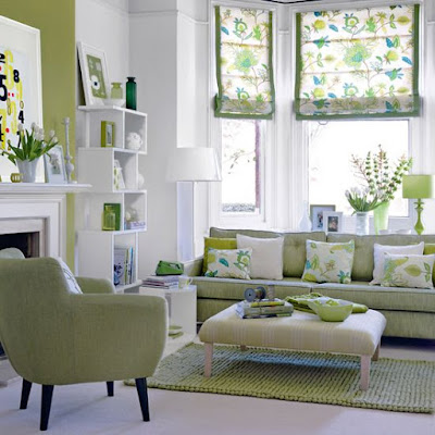 white walls, green accent wall, green sofa, leaf roman shades