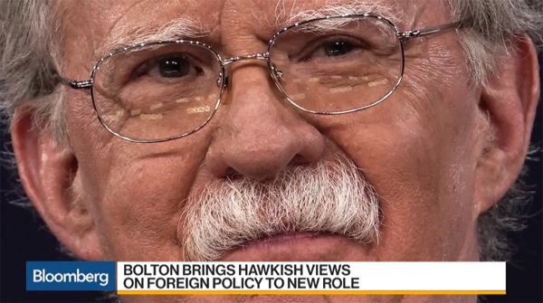 screencap of a Bloomberg video showing an image of John Bolton with the chyron: 'Bolton brings hawkish views on foreign policy to new role'