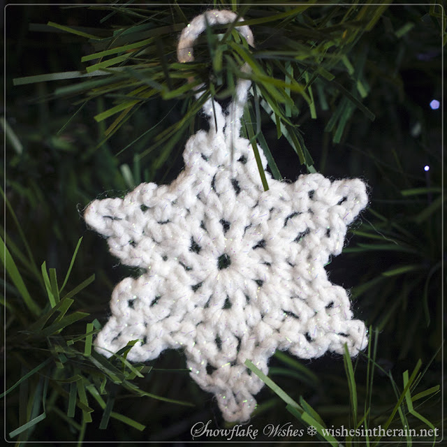 a snowflake hanging from a yarn loop - www.wishesintherain.net