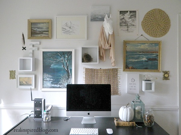 Home Goals 2016: An office gallery wall with faux horse head and ocean theme paintings.