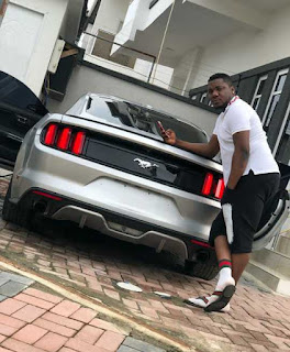 cdq posing with new car