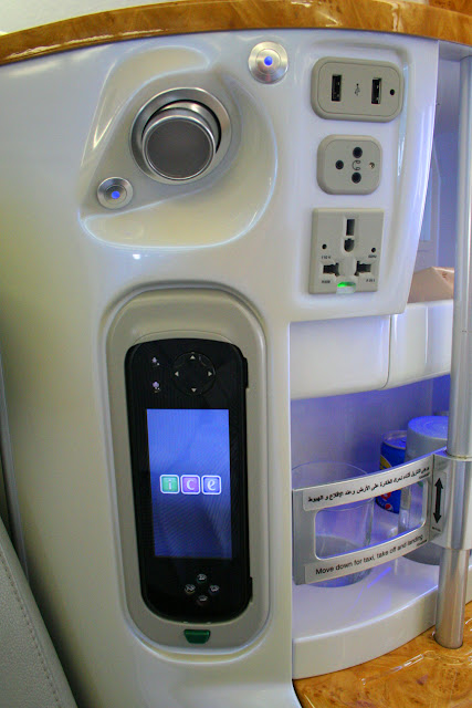 ICE control panel and power outlets aboard Emirates jetliners