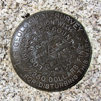 Survey marker on top of Waterman Mountain summit (8036)