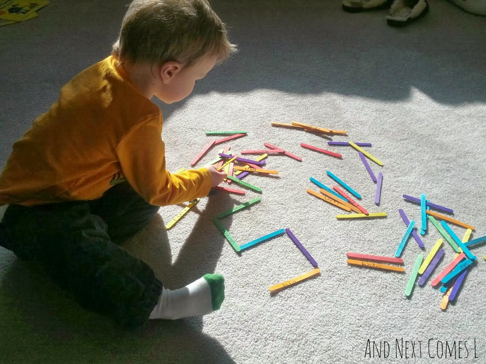 Child with hyperlexia making letters and numbers from And Next Comes L