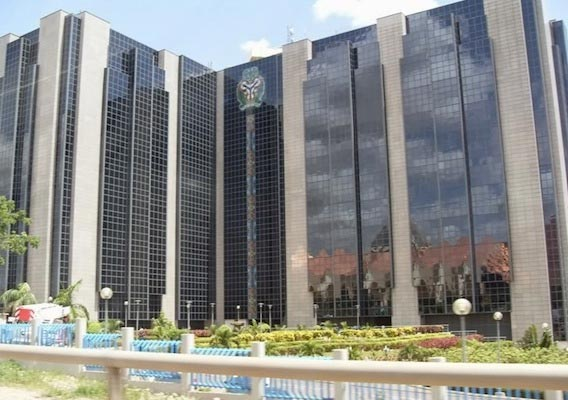 Fulani Herdsmen And Their Cows Pictured In Front Of The CBN, Abuja This Evening