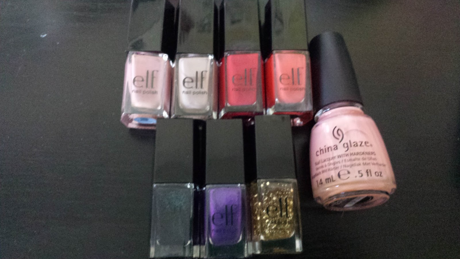 e.l.f. essential 15-piece nail polish set review. Nude, Desert Haze, Smokin Hot, Mango Madness, Sea Escape, Purple Dream, and Gold Star.