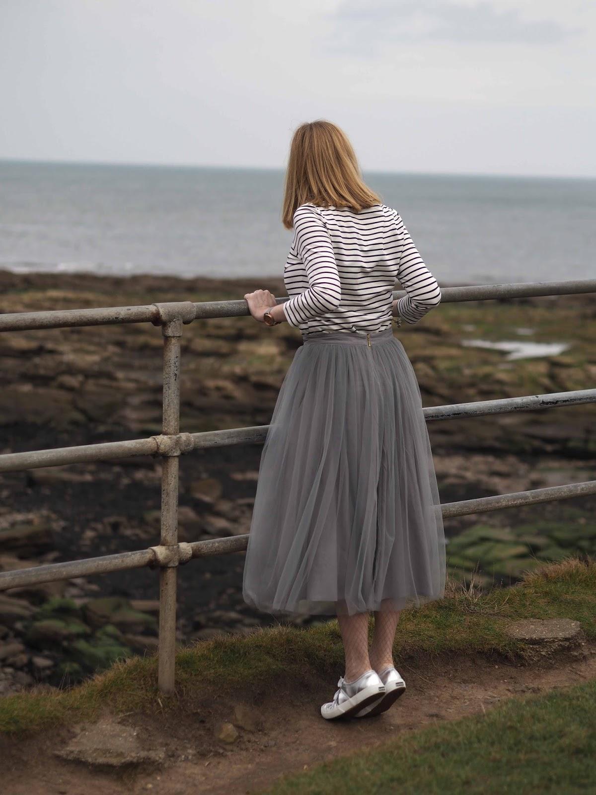 Logo breton top, grey tulle skirt, silver Superga pumps, over 40