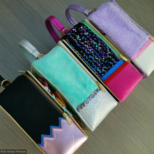 row of 4 irregular choice handbags shown from side with fur and metallic trims