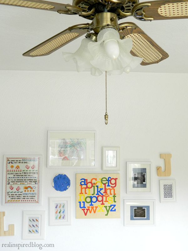 my top five favorite paint colors boys' vintage modern nursery bedroom bistro white walls wooden crib playground rules sign primary colors gallery wall vintage ceiling fan