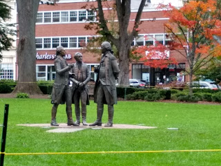 Hamilton, Washington and Lafayette statues, talking together