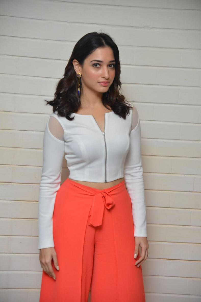 Tollywood Actress Tamanna Spicy Photos In White Top At Movie Interview