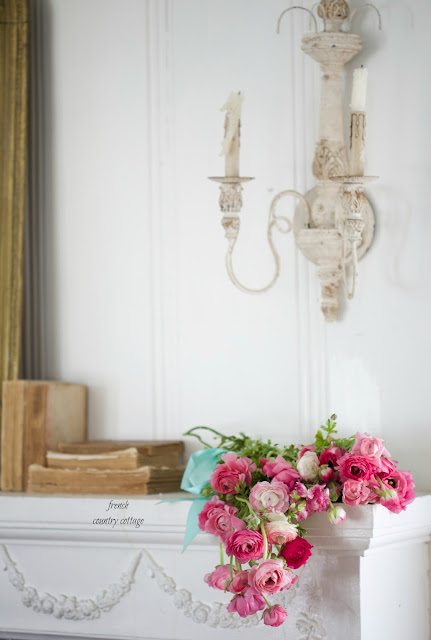 ranunculus flowers on mantel