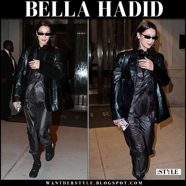 Bella Hadid in black leather balenciaga jacket, black pants dumitrascu and black sneakers model street style march 26