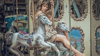 woman on carousel, carousel, horses,