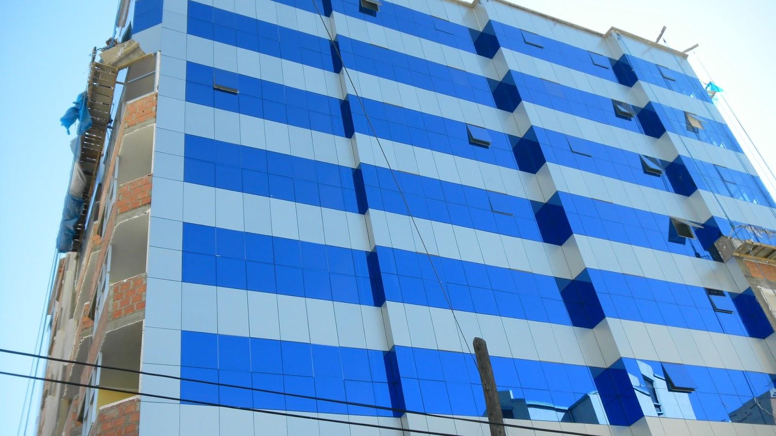 Fachada flotante vidriado alvitec aluminio vidrio for Fachada aluminio