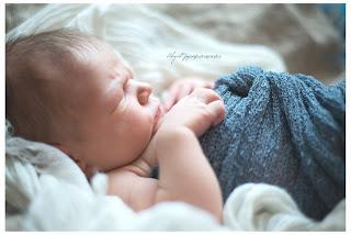 Profile of sleeping baby in blue blanket