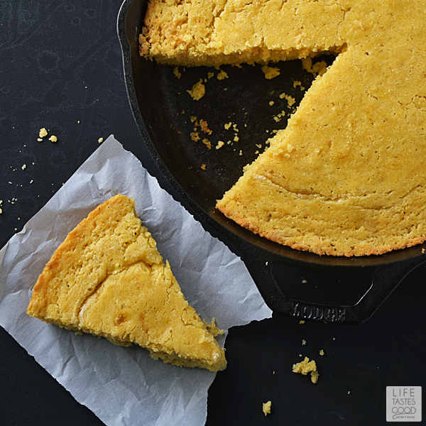 This Skillet Cornbread Recipe | by Life Tastes Good has a touch of honey which adds just the right amount of sweetness! It is a little less dense than traditional southern cornbread, and baking it in the cast-iron skillet gives it a nice crispy outside, but the inside stays moist and delicious. I like that! #LTGrecipes
