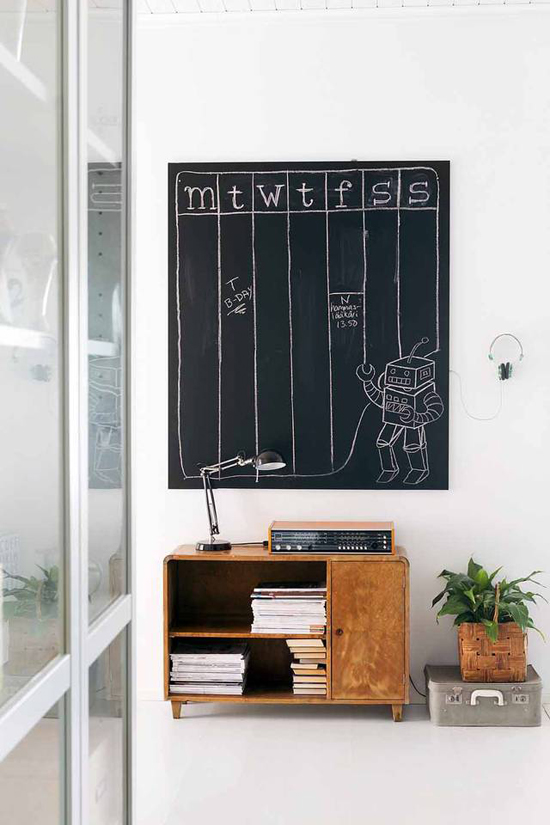 Mid century furniture and handmade chalkboard wall organizer. Photo by Petra Tiihonen via Kotivinkki.