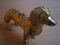 Manualidades con material reciclado - Perro salchicha reciclado con latas