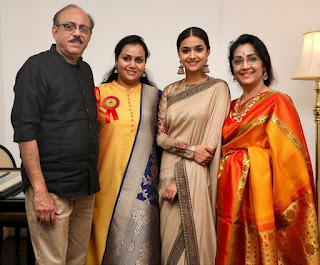 Keerthy Suresh in Saree with Cute Smile along with her Lovely Family