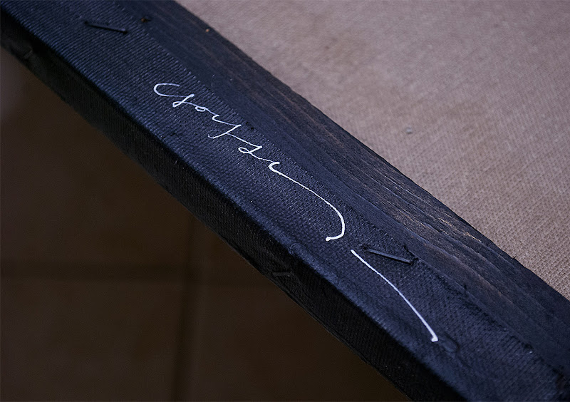 Close Up Photo of Artist Kostas Gogas' Signature on its 'Dark Abstract' Painting at the back of the Canvas