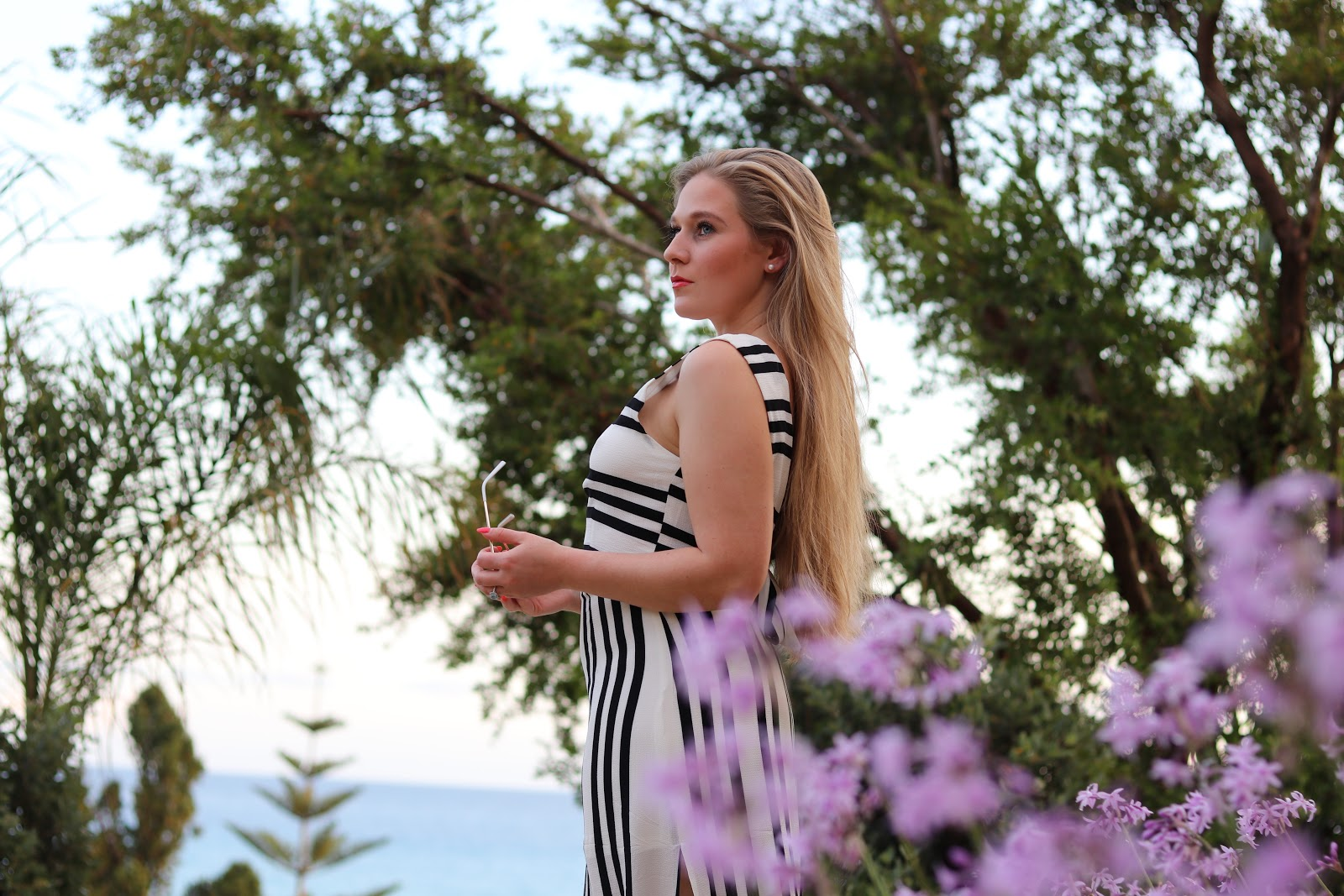 Blonde girl in stripe maxi dress from ASOS at F Zeen Resort, Kefalonia