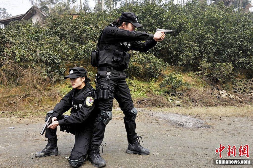 China Tries Three Police Officers For Beating Death of