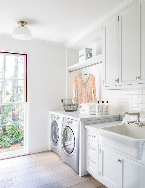 Inspiring warm and rustic white modern farmhouse laundry room by Giannetti Home - found on Hello Lovely Studio