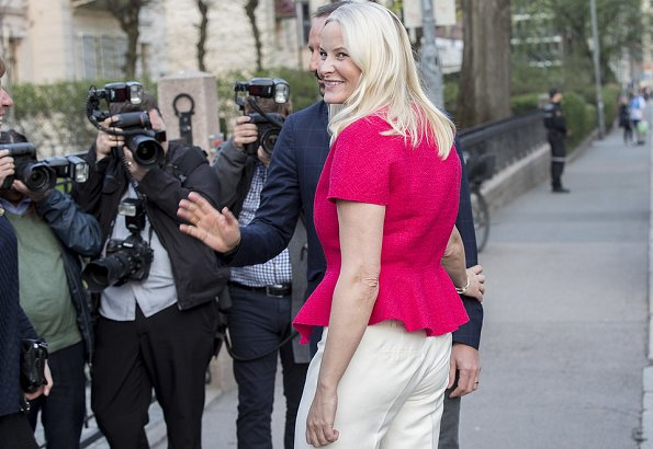 Crown Princess Mette-Marit wore a new belted wool-blend tweed peplum jacket by Oscar de la Renta. Prada shoes