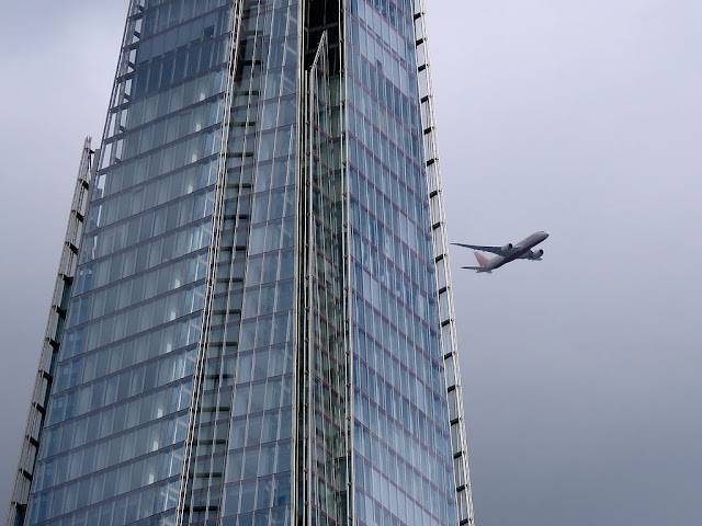 Detail of The Shard with a plane,  London Bridge Street, London