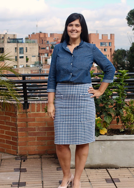 A woman wearing a dotted chambray shirt sewn from the Simplicity 2246/Lisette Traveler sewing pattern, with her hands on her hip.