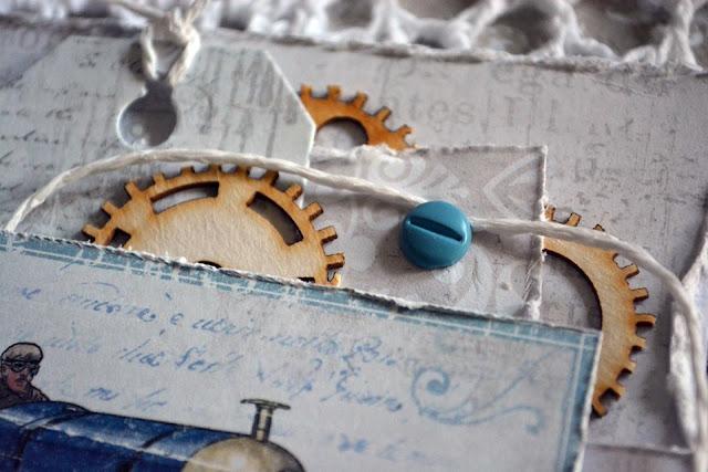 ozdobą kartki są tekturkowe trybiki i metalowe ćwieki