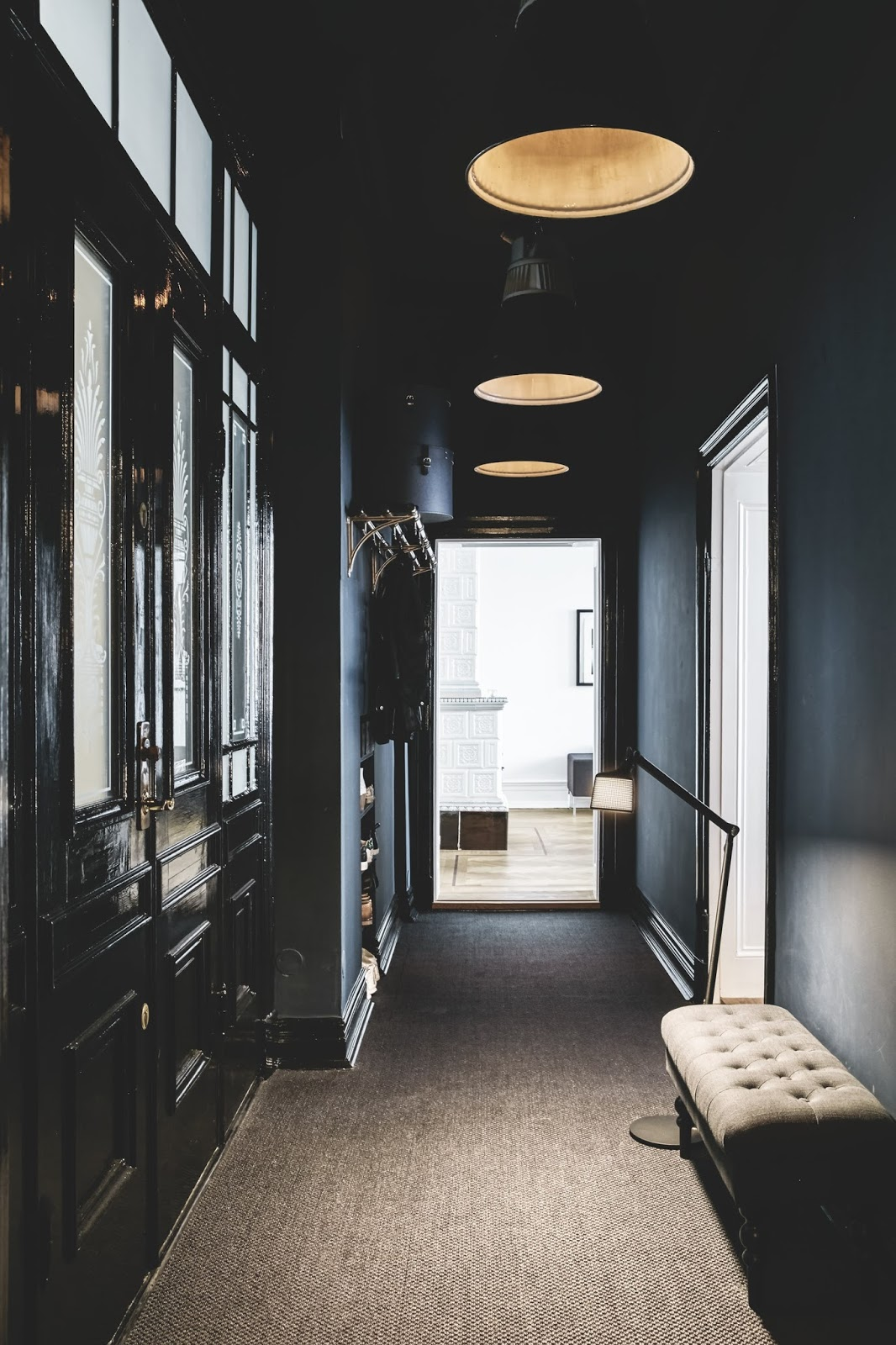black hallway inside of an nordic apartment