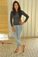 Actress Bhanu Tripathri Pos in Ripped Jeans at Iddari Madhya 18 Movie Pressmeet  0018.JPG