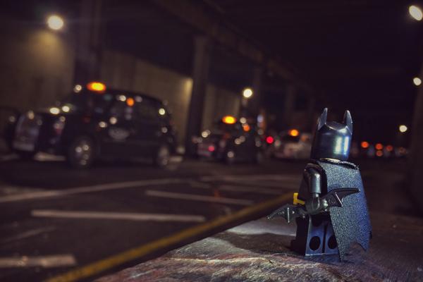 Batman hailing a Cab