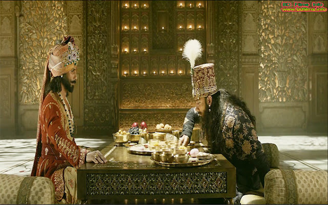 Padmaavat, Not a Historical Film  Padmaavat is the most controversial film ever in India. The film is directed, co-produced, co-edited and music composed by Sanjay Leela Bhansali in 2018. It is the ninth highest-grossing film in India. Sanjay Leela Bhansali is very popular film director in India for his extra ordinary works. For example Devdas (2002), Goliyon Ki Rasleela Ram-Leela (2013, Bajirao Mastani (2015) are the best. Padmaavat is the film of highest amount of budget from his all films. It has achieved most criticisms from the film critics and public audiences.     Performers as characters of the film  There are many performers role played by of the characters in the film. But the most important performers as the characters of the film are;  Deepika Padukone as Rani Padmavati  Shahid Kapoor as Maharawal Ratan Singh  Ranveer Singh as Sultan Alauddin Khilji  Aditi Rao Hydari as Mehrunissa  Jim Sarbh as Malik Kafur   Anupriya Goenka as Nagmati  Ujjwal Chopra as Gora Singh     Plot Summery  The film is started with a sequence of Sultan Jalal-Uddin Khilji in Afghanistan. After, Khilji Dynasty is started in Delhi. Jala Uddin's nephew Alauddin Khilji is the most powerful chief of the Khilji troops. He loots Devagiri, defeats the most powerful Mongols in a battle and after occupies Kara. The plot of the film is of 1303 AD medieval India. At the same time the king of Mewar journeys to Singhal to find out pearls for his wife Nagmati. In the jungle, the princess of Singhal is hunting deer. But unfortunately, her arrow is gone into king's chest. She taks him into a cave and he recovers in her nursing. They fall in love with each other. At that time princess Padmavati was the most beautiful and skilled monarchy. Maharawal Ratan Singh, the king of Mewar finds out princess instead of pearls. The king of Singhal, Gandharvsen, marries his daughter with the king Ratan Singh. They come back to Chittor.     The people of Chittor celebrate the day for the pride of Chittor. Ratan Singh takes Radmavati to their courtier, Raghav Chetan to take blessing. But Ratan Singh banishes him for his fraudulence. On the other side, Alauddin Khilji satisfies his uncle's mind taking the victories. He marries his daughter Mehrunissa with Alauddin. But after some days, Alauddin kills his uncle and with the help of slave Malik Kafur gifted by his uncle. Alauddin becomes the new sultan of Delhi. He fulfilled his every desire. When the courtier of Chittor, Raghav Chetan comes to the fort, he expresses the Sultan telling about the beauty of the queen Padmavati. Sultan Alauddin Khilji starts his journey with troops for Chittor to do a big war. In Chittor, many troops are killed by the technique of Ratan Singh but Alauddin does not go back to Delhi. At last staying there for six months, Alauddin Khilji himself goes to Ratan Singh's fort to do friendship before leaving Chittor. But strategically, Alauddin takes Ratan Singh to Delhi so that Rani Padmavati surely comes to Delhi. Alauddin Khilji accepts all the conditions of Padmavati and kills the courtier. Padmavati journeys to Delhi with 800 men instead of maids. At the same time, Itat Khan tries to kill Alauddin with arrows mixing poison. But he escapes and later kills Itat Khan. Wounded Alauddin cannot meet Padmavati because Mehrunissa helps her to escape Ratan Singh. They flee away from the fort through a tunnel. A little battle is happened. Chief Gora Singh, Badal Singh and all the troops are killed but Padmavati and Ratan Singh reaches Chittor safely. The people of Chittor celebrate to get back their king praise to their queen to escape their king. But Alauddin Khilji takes huge troops in Chittor for a big battle. A battle is started between Alauddin Khilji and Ratan Singh. Ratan Singh is killed by Malik Kafur's arrows. All the troops of Ratan Singh are killed. But Rani Padmavati orders all the women to perform Jauhar (mass self-immolation) closing the gate of the fort. All the women with Rani Padmavati and Nagmati sacrifice their life to protect their dignity.        Story Adaptation  The story of the film is adapted from an epic poem 'Padmavat' written by Sufi Poet Malik Muhammad Jayasi in 1540. He lived in Uttar Pradesh at that time. Epic Poem 'Padmavat' is written in the Hindustani language of Awadhi and originally in the Persian Nastaliq language. The poem is translated in many languages. There is a Bengali version too. It is a fictional poem about Alauddin Khilji's desire about the queen Padmavati of Chittor. In this epic poem Alauddin Khilji and Maharawal Ratan Singh are the historical figures but Ratan Sen's or ratan Singh's wife queen Padmavati is a fictional character, not a historical character. During the second emperor of the Mughal Empire, Humayun (1530-1540) poet Malik Muhammad Jayasi wrote the poem. But he enlisted the matters in the poem of beginning of 14th century (1303 AD) when Sulatan Alauddin Khilji occupied Chittor. 'Padmavat' is the ultimate source of some other adaptation works. Albert Roussel directed Opera 'Padmavat' (1923) in Paris, France.  Besides, a Tamil film named 'Chittor Rani Padmini' (1963) was directed by Chitrapu Narayana Rao. A Hindi film 'Maharani Padmini' (1964) was directed by Jashwat Jhaveri in 1964. All the films have been directed adapting the poem story 'Padmavat'.     Plot of the Poem  Gandharvsen was the king of Singhal. The princess of Singhal Padmavati was very beautiful. The women of Singhal was called Padmini specially they were beautiful and had four kinds of skill or quality. Padmavati had a talking parrot named Hiraman. Hiraman was very close friend to the princess, Padmavati. They together studied the Vedas, the Hindu scriptures. But the king of Singhal resented the parrot's closeness to his daughter. So, he wanted to kill the parrot. But the parrot bade good bye to the princess and few away in the jungle. A bird catcher caught the parrot and sold it near the Chittor Empire to a Brahmin. The Brahmin took it to the king of Chittor Maharawal Ratan Sen. Ratan Sen was very fond of to the parrot because the parrot could talk sweetly. The parrot talked about the beauty of the princess of Singhal Ratan Sen started his journey to marry Padmavati with 16,000 followers with the parrot's guide. They went to Singhal after crossing seven seas and Ratan Sen came to a temple and commenced austerities to seek Padmavati. Padmavati came to the temple after listening from the parrot but did not meet with the ascetic. She returned to the palace. Ratan Sen was very upset and committed to suicide. But he was interrupted by the deities Shiva and Parvati. On Shiva's advice, they attack on the royal fortress of Singhal kingdom. But they are defeated and when Ratan Sen was about to be executed, the parrot expressed his identity; the king of Chittor. At that time Gandharvsen released the prisoners and marries his daughter with the king Ratan Sen. He also arranged 16,000 Padmini women as companion for the 16,000 men. Ratan Sen started his journey to return Chittor after hearing the message from a bird sent by his wife Nagmati. But at the sea, all the men and women were killed by a strong storm except Padmavati and Ratan Sen. Lakshmi was the daughter of the god Ocean. She wanted to test Ratan Sen's love to his wife Padmavati. He succeeded and got many gifts from Lakshmi. They came back to Chittor. Ratan Sen banished the courtier Raghav Chetan for fraudulence in a test.     Sometimes, rivalry developed between Ratan Sen's two wives, Nagmati and Padmavati. Raghav Chetan went to the fort of Sultan Alauddin Khilji and expressed the exceptional beauty of Chittor's queen, Padmavati. Sultan Alauddin Khilji wanted to obtain Padmavati and besieged Chittor. But after failing to conquer Chittor, he feigned a peace of treaty with Ratan Sen and took him to Delhi. Rani Padmavati ordered Gora and Badal to help Ratan Sen. Badal disguised as Padmavati, Gora and the followers rescued Ratan Sen. But Gora was killed and Badal reached Chittor with Ratan Sen safely. When Ratan Sen was imprisoned in Delhi, Devpal the Rajput king of Chittor's neighbor Kumbhalner, proposed to marry Padmavati through an emissary. But hearing this, Ratan Sen, after coming Chittor, decided to punish Devpal. A battle is started between Ratan Sen and Devpal. Unfortunately, Ratan Sen and Devpal killed each other. At that time, Alauddin Khilji again attacked Chittor but Padmavati and Nagmati committed self immolation (Sati) on Ratan Sen's funeral pyre. All the men of Chittor fought to death against Alauddin Khilji and the women of Chittor committed mass self immolation (Jauhar). Alauddin Khilji acquired nothing but an empty fortress. He picked up the ashes of Ratan Sen and his wives Nagmati and Padmavati and lamented that he 'wanted to avoid this'. He continued 'desire is insatiable, permanent/but this world is illusory and transient/insatiable desire man continues to have/till life is over and he reaches his grave.'           Analysis of Film Story, Poem Story and Actual History  'Padmaavat' is an action drama film not a historical film and it does not reflect the history of the historical figures, Maharawal Ratan Singh and Sultan Alauddin Khilji. 'Padmaavat' movie also does not reflect the poem story of the famous Sufi Poet Malik Muhammad Jayasi. Sanjay Leela Bhansali has adapted the film story in his own way. Actually, if we look at Satyajit ray's work 'Pather Panchali' (1955), we will get the right answer. There are many differences between Bibhutibhushan Bandyopadhyay's Pather Panchali novel story and Satyajit Ray's Pather Panchali movie story. In Pather Panchali movie, Satyajit Ray has added many sequences' story that is not in the original novel though he adapted the film story from 'Pather Panchali' novel. Similarly, Sanjay Leela Bhansali's 'Padmaavat' movie has been adapted from the poem of Malik Muhammad Jayasi's poem 'Padmavat'. But there are many differences between the actual poem story and the film plot summery. This is why I have pointed out the two stories from the film and the poem. For example; Sultan Alauddin Khilji did not kill Maharawal Ratan Singh in the epic poem. Ratan Singh and Devpal have killed each other. But in Sanjay Leela Bhansali's movie 'Padmaavat' it has been shown that Sultan Alauddin Khilji has betrayed with Ratan Singh and killed him. So, there are many differences between the two stories. Director Sanjay Leela Bhansali has adapted the film story in such way director Satyajit Ray had adapted his Pather Panchali film story. But here, Sanjay Leela Bhansali has shown nothing but a tale of good Vs evil. In this film, he has upheld the Rajput king, queen and everyone from Rajput Empire as good. On the other hand, he has made Khilji dynasty or Khilji troops or everyone from Khilji Empire as evil. But there is exception that Sanjay Leela has made a character Mehrunissa empress of Delhi Sultanate as good. In Jayasi's poem, he has written, Ratan Singh went to Singhal kingdom only for love, only to marry Padmavati. But Sanjay Leela Bhansali has shown in his movie that Ratan Singh has gone Singhal to search pearls for his wife Nagmati. But there some own creation of the director for example; when the pavilions are burning from the firing arrows from the Rajput troops, Sultan is looking everything from bed at night. Besides, in another sequence, all the Khilji troops want to go back to Delhi but Sultan shows his strategy to them and they stop themselves to go back from Chittor to Delhi. Besides, in front of sultan, on the table, there are many food items he engulfs all food items like animal. It is Director's own creation. But is it controversial or not we will know later. Another example; sultan is changing the two food plates at the time of eating food into the fortress.  Besides, in the battle, Ratan Singh and Sultan Alauddin Khilji both of them are fighting but Malik Kafur killed Ratan Singh with his arrows. Actually, it is not in Jayasi's poem. Ratan Singh and Devpal killed each other. But in 'Padmaavat' director has shown that Malik Kafur has killed Ratan Singh. For this reason, we should know the actual history of the two historical figures Maharawal Ratan Singh and Delhi Sultan Alauddin Khilji. Many historians told that the history Maharawal Ratan Singh and Sultan Alauddin Khilji are the two prominent historical figures but there is no clue in history that Rani Padmavati is a historical figure. Sufi poet Malik Muhammad Jayasi has told his own words in the poem that 'I have made up the story and related it.' Padmavati character is fictional and this story is poet's imagination. So, Padmavati is not a historical figure or character.     Changing Film Story as Fictional  I have told before that it is not a historical film. it is a work of fictional and director's imagination. Though there are some similar parts or stories that have been taken from the Sufi poet Malik Muhammad Jayasi's 'Padmavat' poem (1540). Most of the story of the film has been taken from the poem. But there are some parts that are director's imagination or own creation. The creative works of the director have been enlisted on the above that we have already known. There is no historical authenticity of the film and it is a fictional work. Director Sanjay Leela Bhansali acknowledges the recognition writing disclaimers in the film screen. His disclaimers are 'This film 'Padmaavat' is inspired from the epic poem Padmavat, written by Malik Muhammad Jayasi, which is considered a work of fiction. This Film does not infer or claim historical authenticity or accuracy in terms of the names of the places, characters, sequence of events, locations, spoken languages, dance forms, costumes and/or such other details. We do not intend to dispresent, impair or disparage the beliefs, sentiments of any person(s), community(ies) and their culture(s), costume(s), practice(s) and tradition(s).' Director Sanjay Leela Bhansali has added another disclaimer that this film does not intend to encourage or support 'Sati' or such other practices.' He also added that 'all the animals & birds in this film have been treated with extreme love, care & concern in the presence of veterinarian doctors. Computer graphics were used for deer, horses, camels, elephants, bullocks, love birds, ostrich, white Macaw and parrots. Animatronics horses were used for better quality purpose.' So, there is no controversy from this side that it is a fictional work and not a historical film. Director only has upheld the background and set design of the film of 1303 AD medieval India. He has upheld some historical figures or historical characters for example; Maharawal Ratan Singh the king of Chittor and Sultan Alauddin Khilji of Delhi but here Padmavati character is not historical figure. It is an imaginary character of the Sufi Poet Malik Muhammad Jayasi.     Political and historical controversy between the Hindus & the Muslims     In reality, the main problem of the film is with the history itself. The main controversial part of the film is its political and historical background. The Hindus and the Muslims of India protested before releasing the movie with their different ideology. The Hindus are thinking that it is a distortion of Rajput community history but the Muslims are thinking that here, the Muslims are shown very roughly specially the Muslim ruler Alauddin Khilji.     Besides, there are many objections and claims of the Hindus and the Muslims about the history and film contents. Some Hindus of India have objected it such a way that the content of the film, claiming, it insults the Rajput community and is a distortion of history, which hurts their religious sentiments.' Some others claim about its 'Dream Sequence' or they object that it is a romantic scene between Rani Padmavati and Alauddin Khilji.' Some others Hindus from Rajput community claim that film directors are portraying the film as a love story between Alauddin Khilji and Rani Padmavati, which is distortion of history.' One BJP (Bharatiya Janata Party) MP claims 'We will not tolerate any distortion of our history.' Actually, their main controversy about the film is that 'Changing the story of the film.' A BJP MLA claims that 'I will not allow any distortion of the valiant history of Rajsthan.' Most of the Rajput community claims that 'the filmmaker has presented distorted facts about Rani Padmavati which is an insult to the Rajput community.' Before releasing the cinema, many BJP leaders protested to stop its release because they did not want any distortion of their Rajput community history.' A BJP MLA claims that 'if the film depicts history without any distortion and highlights the valour of Rajputs, we will welcome it. But if it portrays them in poor light then we will not allow its release in theatres.' But at last director Sanjay Leela Bhansali becomes winner through Indian law and court. It has been released. Many Rajput community organizations protested to stop its release specially 'Shri Rajput Karni sena' an organization of Rajput community protested to ban the film. Besides, several Muslim leaders protested to ban the film because they claim that the film is misleading the history of Delhi Sultan Alauddin Khilji.' The film has been banned in Malaysia for negative portray of Sultan Alauddin Khilji, a Muslim ruler.' Besides, many unfortunate events have been occurred during the pre-production and production time. Many filmic ingredients have been broken, director was slapped on set, hair was pulled and the lead actress was threatened with beheading or having her nose cut off and many unnatural events.  Some English critics claim that Padmaavat does not match with Padmavati. But the main thing is it is a work of fiction. The professor of history at Rajsthan University Krishna Gopal Sharma tells that 'Padmini was 15th wife of Maharawal Ratan Singh; Alauddin Khilji was enamored by Padmini's beauty and saw her reflection in water is a myth and its root from Padmavat poem written by Malik Muhammad Jayasi.'                 Historical and Political Criticism  If a film is historical, the film cannot be a fictional film. History is the political story of past. Fiction is something imaginary that is not related to history. History is the true story of past. For example; Mangal pandey: The Rising (2005) is a historical film directed by Ketan Mehta and the lead actor is Aamir Khan. It does not expose any false or imaginary events. But it only expresses the truth of past political background of the year 1857 of Indian subcontinent. Director Sanjay Leela Bhansali has made the film story mixed with political history and imaginary story. So, it is not a historical film. It has some background of history. Director Sanjay Leela Bhansali has told that the film is not historical; it is imaginary and fictional work. Sufi poet Malik Muhammad Jayasi also said that the story of the poem is not historical but is imaginary and a work of fiction. Director Sanjay Leela Bhansali has acknowledged that. But most of the Rajput communities do not know that the character Padmavati is not a historical figure but an imaginary character only. Amir Khashru one of the famous historians of that Time has written the history about Maharawal Ratan Singh and Sultan Alauddin Khilji but he did not refer any kind of historical figure named Padmavati. When the audiences will watch the movie, at the first sight, they will tell that the movie is historical. But the audiences, who know the actual history and political background of Sultan Alauddin Khilji and Maharawal Ratan Singh, can tell that this is not a historical film but a fictional film. Besides, there are many scenes which are portraying false story of Sultan Alauddin Khilji. Actually, the whole film portrays the Muslims very roughly. Director Sanjay Leela Bhansali portrays the Rajputs as good and the Muslims as evil.     Freedom of speech ends where defamation begins  Before, I have said that in this film director has portrayed the Muslims as evil. It is not historical film but he has taken the shelter of history and has portrayed it with the help of imagination. It is fictional it is not a historical film but a work of fiction. We all know that freedom of speech is basic right for the people in most of the countries in the world. But when defamation begins, the freedom of speech is ended. In this film portraying the Muslims as evil is also defamation. It is a fictional work but director has no right to uphold the Muslims in such way.  It is not a historical film, it is a fictional film. Then it is a work of fiction but it's nothing but a tale of good Vs evil. We should keep in mind that there are two kinds of religious people here; Hindus and Muslims. And the main controversy to the Muslims here that Muslims are shown very roughly or Muslims are evil and Hindus are good. Director has directed it through his own imagination and perspective but it is unethical to defame only the Muslims here, overall. Most of the people of India are Hindus and there are hardy some Muslims. So, as much as the Hindus pretested against the film to be released, the Muslims could not pretest. Its main cause would be now conservative BJP is the government Party in India and the Muslims cannot talk against them; it is natural. It is the most controversial film to the religious people of Indians as well as all over the world.        References   1. Padmaavat movie (2018)  2. Villagevoice.com   3. Theguardian.com  4.  Hollywoodreporter.com   5. Theglobeandmail.com   6.  Nytimes.com   7. Youtube.com   8. Youtube.com   9. Metacritic.com   10. Bollywoodhungama.com   11. Imdb.com   12. Rottentomatoes.com   13. Wikipedia.com