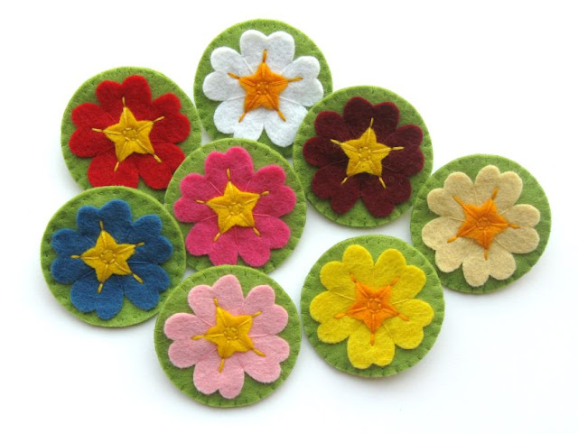 Felt primula or primrose brooches
