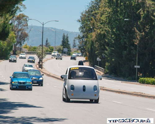 self driving car by google on road