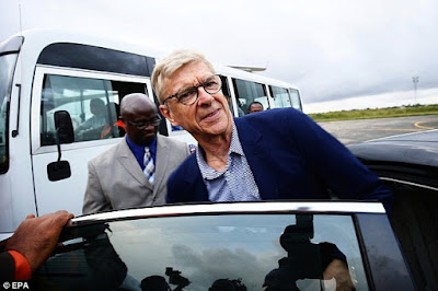 Arsene Wenger getting into a car