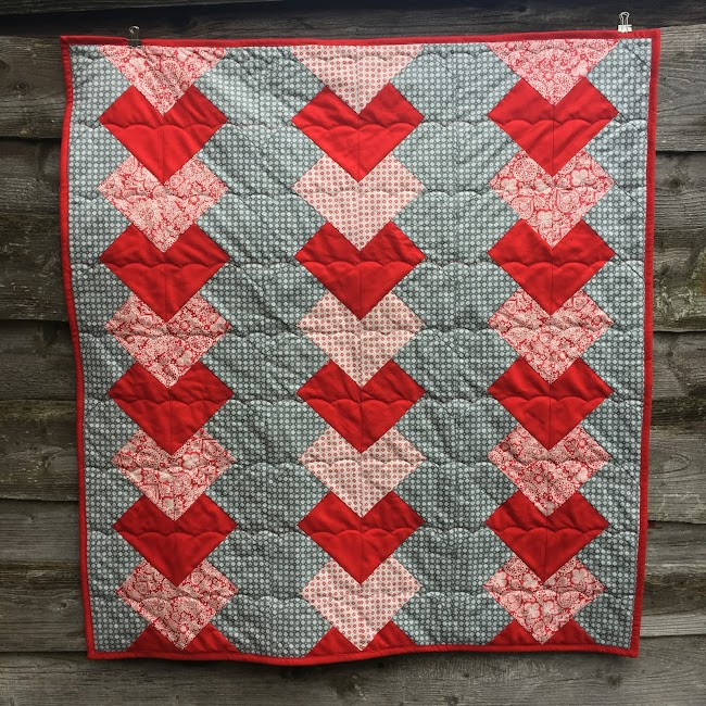 red and grey braid quilt