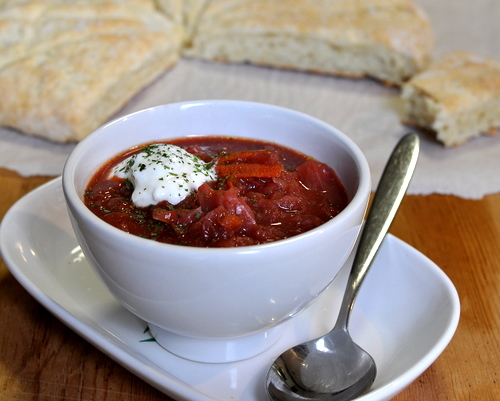 Karelian Borscht (Russian Beet Borscht Soup) ♥ KitchenParade.com, extra hearty with sausage and a swirl of sour cream but also especially earthy and delicious as a vegetarian borscht.