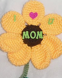 http://www.ravelry.com/patterns/library/free-pattern--mothers-day-magnet-a-crochet-pattern