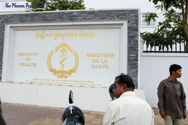 People stand outside the Ministry of Health on Phnom Penh's Street 289 last year. Pha Lina