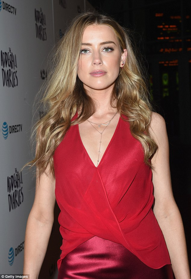 Amber Heard in a slinky plunging gown at the premiere of 'The Adderall Diaries'
