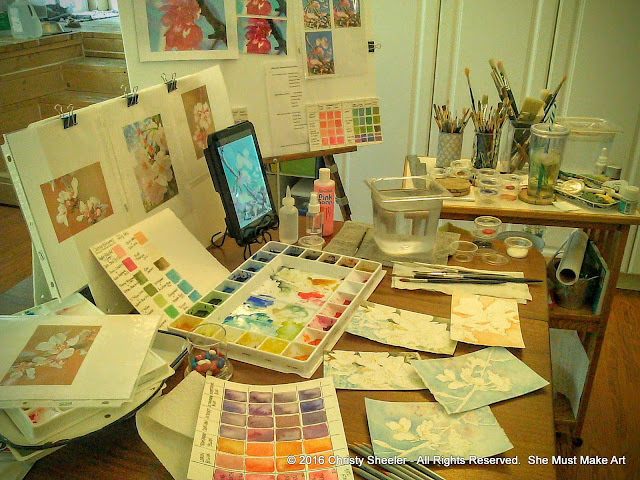 A full view of my art table with the cherry blossoms paintings in progress.