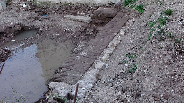 Ancient defensive wall section surfaces during salvage excavation on Greek island of Lesvos