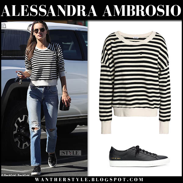 Alessandra Ambrosio in striped black and white splendid sweater, jeans and black sneakers common projects model street style october 16
