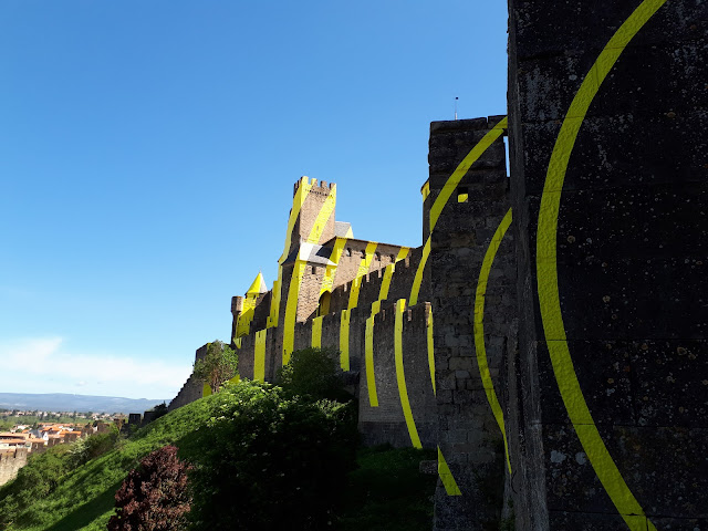 Carcassonne castle with Felice Varini yellow lines